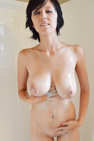Busty girl is showering